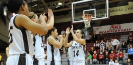 Image courtesy of GoBonnies.com: Senior guard Jessica Jenkins high fives her teammates before a game.