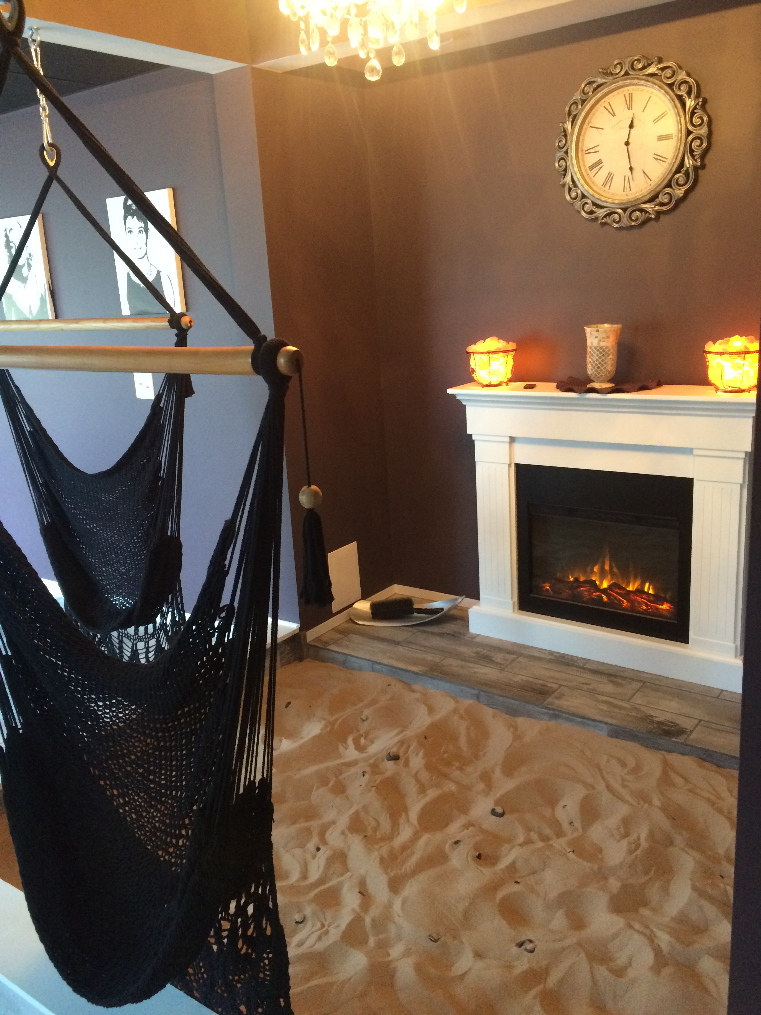 Swinging into Relaxation- customers can sit in the Himalayan swings hanging above sand pits at Skin Tight Studio
